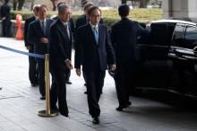 前韩国总统李明博面临贿赂指控      接受调查 21 小时后返家