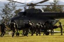 巴布亚省横贯公路枪击案   :    军警综合人员致力追捕凶手