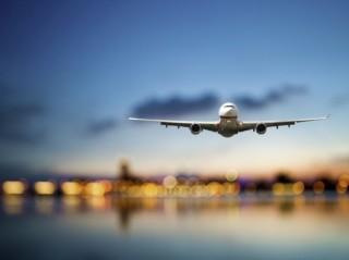 媒体社论谈国内机票价格波动背后原因