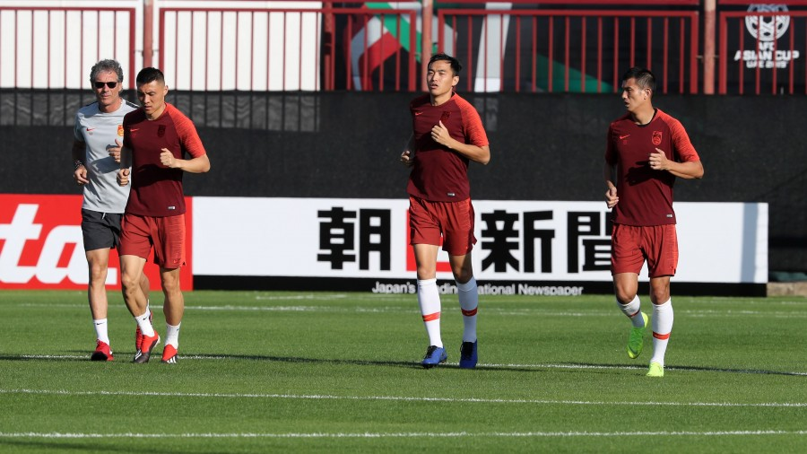 China football team during a training session, ahead of the UAE 2019 AFC Asian Cup, in Abu Dhabi on January 3, 2019. (Photo by KARIM SAHIB / AFP)