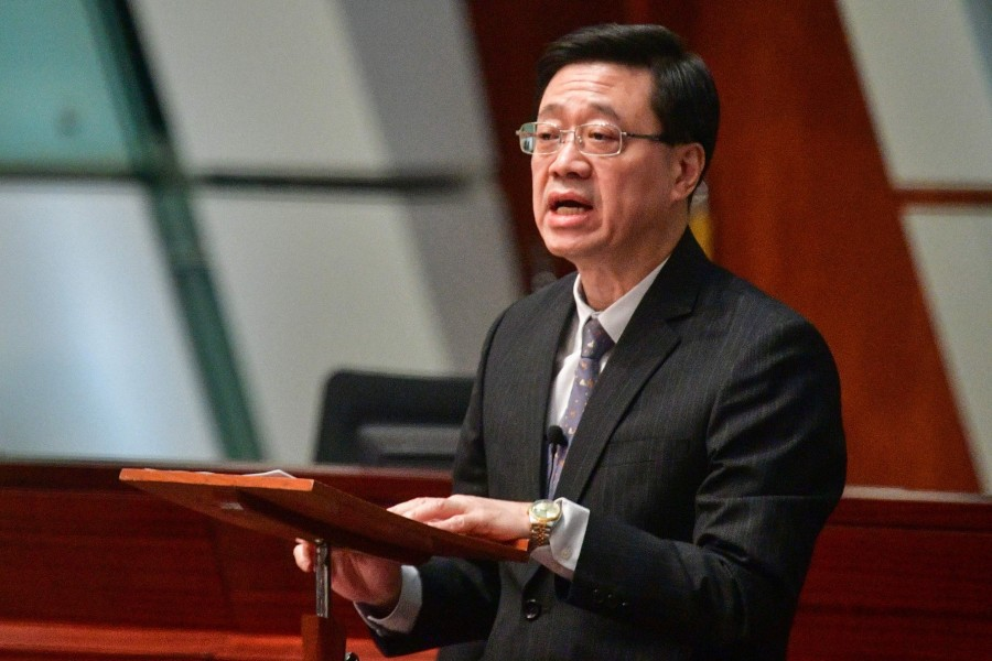 Hong Kong Secretary for Security John Lee officially withdraws the extradition bill on October 23, 2019.  (Photo by Anthony WALLACE / AFP)