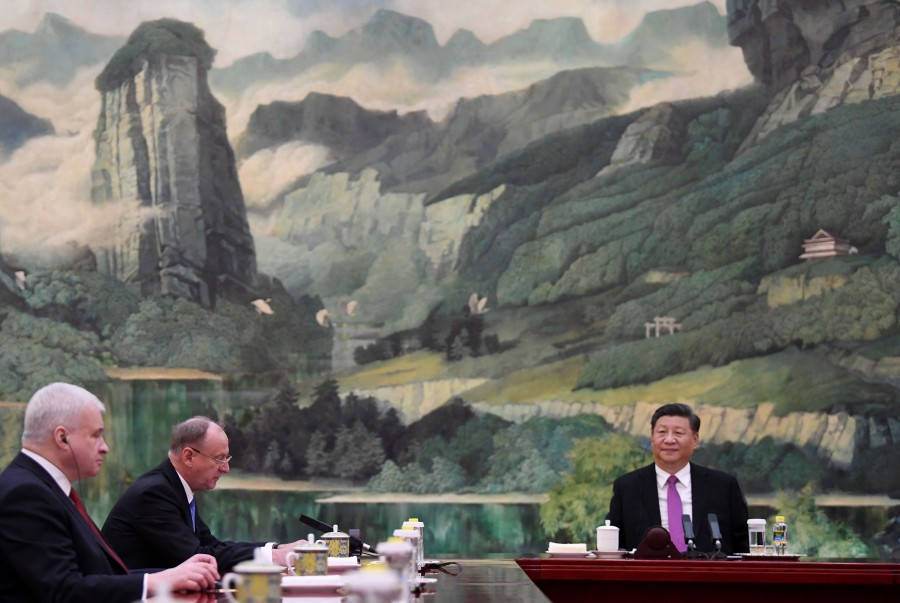 President Xi Jinping listens meeting with Russia security council secretary Nikolai Patrushev (2nd L) at Beijing on December 2, 2019. (Photo by Noel CELIS / AFP)